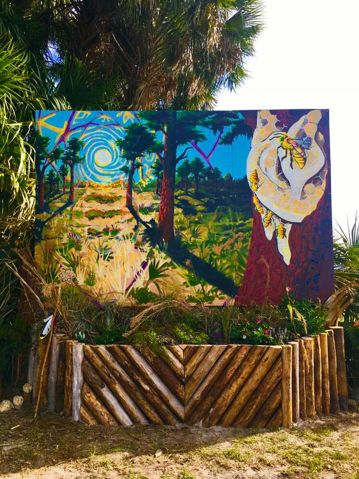 Bee Aware mural at the Okeechobee Music Festival. Created by heartspace art, this mural has a message about the importance of bees in our ecosystem.