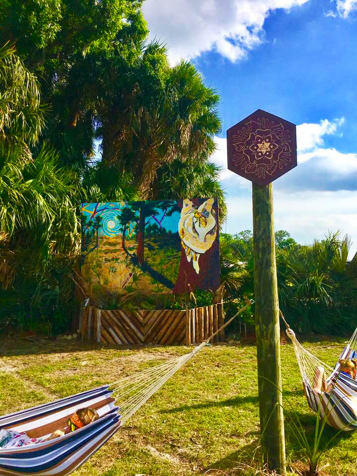 Bee Aware mural at the Okeechobee Music Festival. Created by heartspace art, this mural has a message about the importance of bees in our ecosystem. This photo is a close up on the lighting pillars.