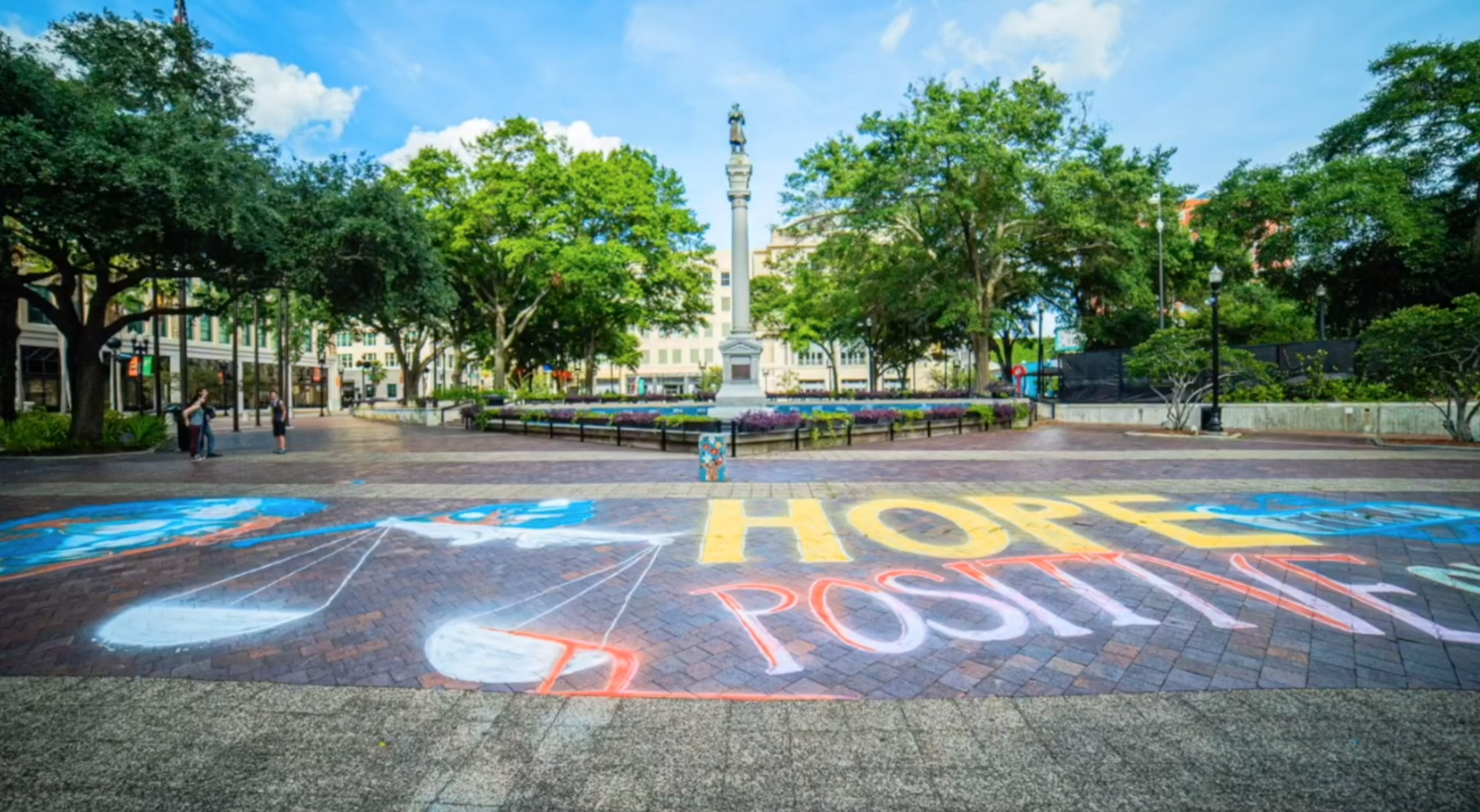 Chalk mural with a message representing the imbalance of justice in the United States created by Heartspace Art at James Weldon Johnson Park in Jacksonville, Florida.