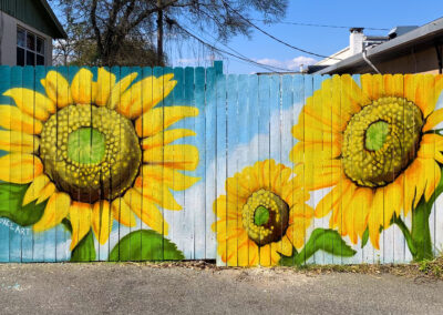 A mural painted at Murray Hillbilly, plant based southern comfort food, in Jacksonville Florida by Ian and Danielle Cleary of Heartspace Art.