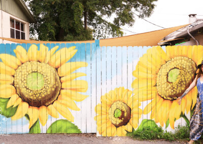 A mural painted at Murray Hillbilly, plant based southern comfort food, in Jacksonville Florida by Ian and Danielle Cleary of Heartspace Art. Jacksonville, FL